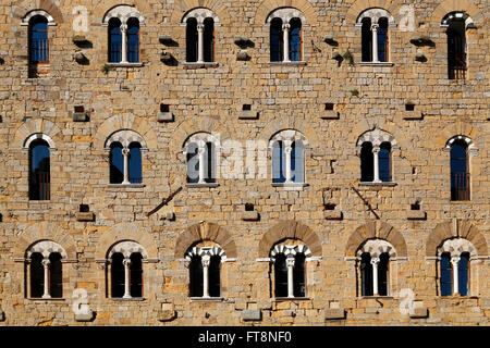 Classic windows in an old stone building - Stock Photo