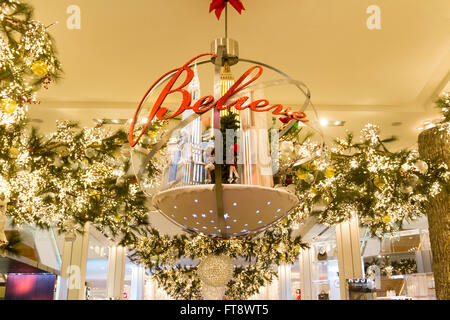 Christmas Sign in department store. - Stock Photo