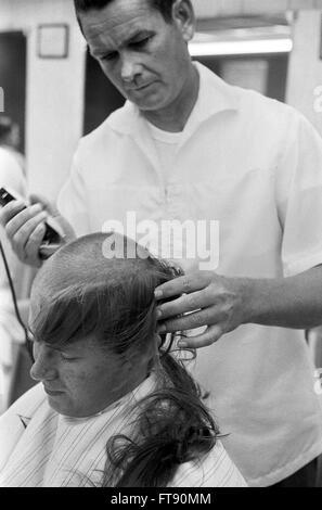Vietnam Draft. A newly drafted soldier getting a haircut at Fort Jackson, Columbia, South Carolina, May 1967. - Stock Photo