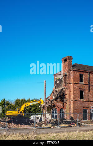 An old building being demolished following fire damage. - Stock Photo