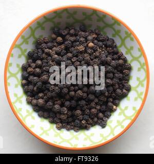 Black Peppercorns - Stock Photo