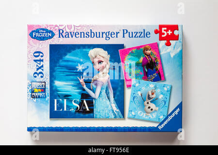 Disney Frozen Ravensburger Puzzle jigsaw puzzle with three separate puzzles of Elsa, Anna and Olaf isolated on white - Stock Photo