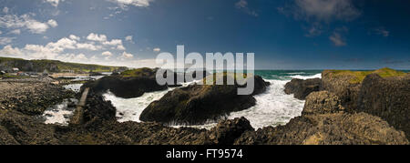 Ballintoy Harbour and coastline in County Antrim, Northern Ireland, UK - Stock Photo