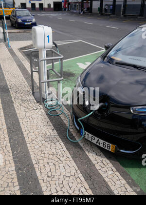 Electric car being charged at public charging point, Madeira, Portugal, March 2016 - Stock Photo