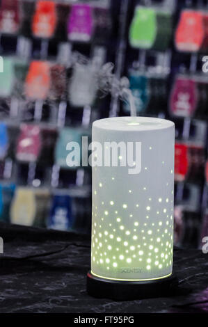 A Scentsy lamp and vapouriser on display at a market stall - Stock Photo