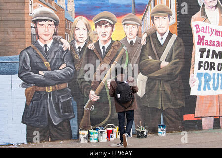 West Belfast, Ireland. 25th March, 2016. A Tourist looking at a Mural at the international Wall. tis is part of the  Preparation for the Commemoration of the 100th Anniversary of the Easter Rising On Sunday 27th March 2016 Credit:  Bonzo/Alamy Live News Stock Photo