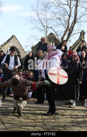Heptonstall, UK, 25th March 2016. 'St George' fights 'Slasher' in the pace egg play in Heptonstall, UK, 25th March - Stock Photo
