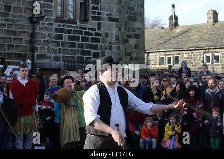 Heptonstall, UK, 25th March 2016. A sword thrower during a performance of the pace egg play in Heptonstall, UK, - Stock Photo