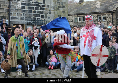 Heptonstall, UK, 25th March 2016. Characters in weavers square for the pace egg play in Heptonstall, UK, 25th March - Stock Photo