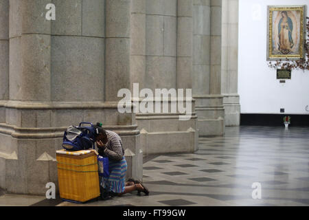 Sao Paulo, Brazil. 25th Mar, 2016. A woman prays inside Sao Paulo See Metropolitan Cathedral, prior to a procession - Stock Photo