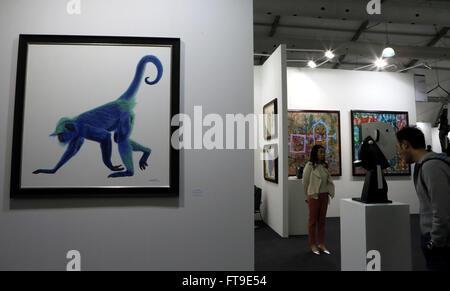 Hong Kong. 26th Mar, 2016. Visitors watch creations displayed at the Contemporary Art Expo in Hong Kong, south China, - Stock Photo