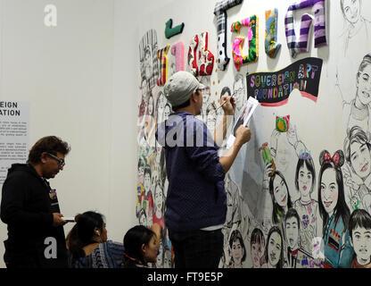 Hong Kong. 26th Mar, 2016. An artist draws at the Contemporary Art Expo in Hong Kong, south China, March 26, 2016. - Stock Photo
