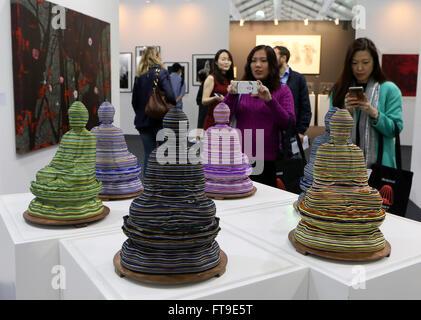 Hong Kong. 26th Mar, 2016. Visitors watch a creation displayed at the Contemporary Art Expo in Hong Kong, south - Stock Photo