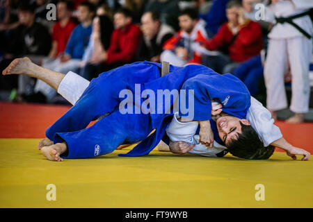 Chelyabinsk, Russia -  March 19, 2016: fight of two athletes wrestlers during Russian competition on judo - Stock Photo