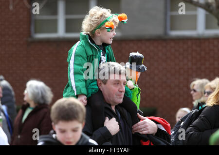 Child on father's shoulders at St. Patrick's Day parade Yonkers New York - Stock Photo