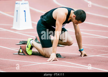 Chelyabinsk, Russia - July 05, 2015: Man athlete in starting position during Championship of Russia on track and - Stock Photo
