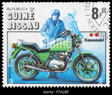 BUDAPEST, HUNGARY - 18 march 2016:  a stamp printed in the Guinea-Bissau shows Kawasaki, Motorcycle Centenary, circa - Stock Photo