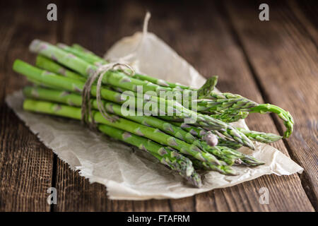 Green Asparagus (fresh harvested) on an old wooden table (selective focus) - Stock Photo