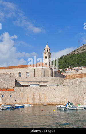 View of fortified Dominican Monastery (founded in 1315) from Old Port of Dubrovnik, Croatia. World Heritage site - Stock Photo