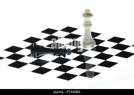 chess pieces on the board on a white background - Stock Photo