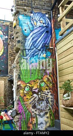 London street art uk wildlife. Brixton street art mural London graffiti on buildings - Stock Photo