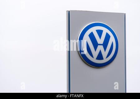 Volkswagen (VW) car manufacturer sign logo. - Stock Photo
