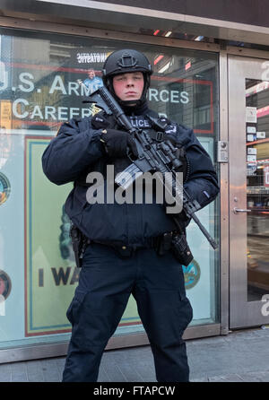 Portrait of a policeman from the NYPD counterterrorism unit patrolling in Times Square, Manhattan, New York City. - Stock Photo