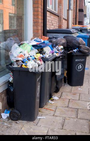 Overflowing rubbish bins in Birmingham, UK - Stock Photo