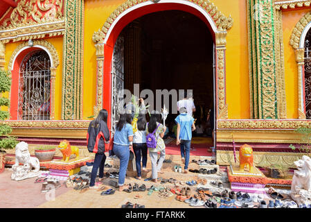 Shoes in front of Buddhist temple Vientiane Laos - Stock Photo