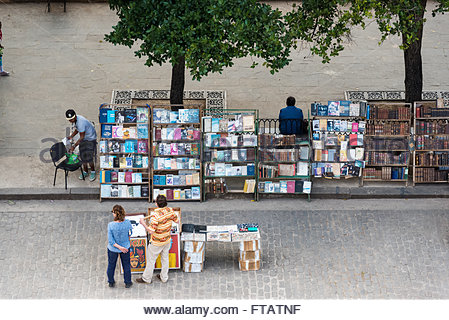 Old Havana Plaza de Armas or Book Market aerial view: Tourists buying painting and books at antiquities stands - Stock Photo