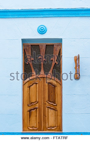Colonial  house reconstructed for Hostel details: Blue Vintage hostel with precious wooden doors and windows. - Stock Photo