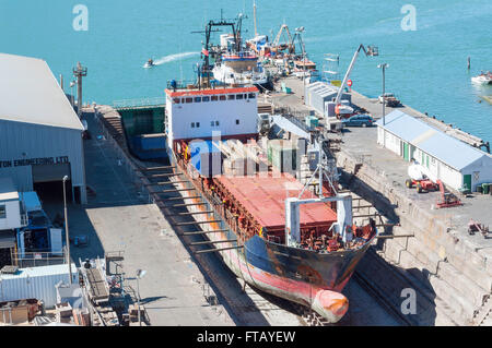 Ship in dry dock, Port of Christchurch, Lyttelton, Lyttelton Harbour, Banks Peninsula, Canterbury, New Zealand - Stock Photo