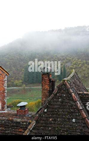 Early morning mist over the valley. Rocamadour - Stock Photo