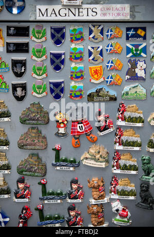 Kitsch Scottish Fridge Magnets are seen pinned to a dirty board on the Royal Mile in Edinburgh - Stock Photo