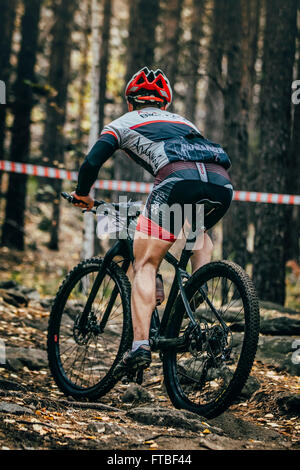 Sludorudnik, Russia - September 13, 2015: racer cyclist rides along ground and stones during Blagikh Racing Cup - Stock Photo