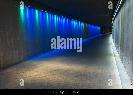 empty underground concrete tunnel with colorful lighting - Stock Photo
