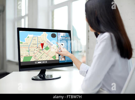 close up of woman with navigator map on computer - Stock Photo