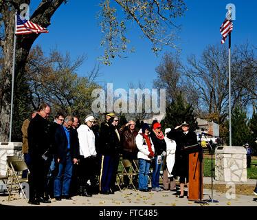 Emporia, Kansas, USA, 11th November, 2014 Army Captain Laura Webb USA Medical corps gives the final salute at the - Stock Photo