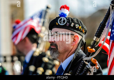 Belfast, Northern Ireland. 27 Mar 2016 - Bagpiper from New York at the Easter Rising centenary celebration parade. - Stock Photo