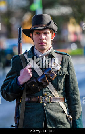 Belfast, Northern Ireland. 27 Mar 2016 - A man dressed in Irish Citizen Army uniform from 1916, and carrying a 'Howth' - Stock Photo