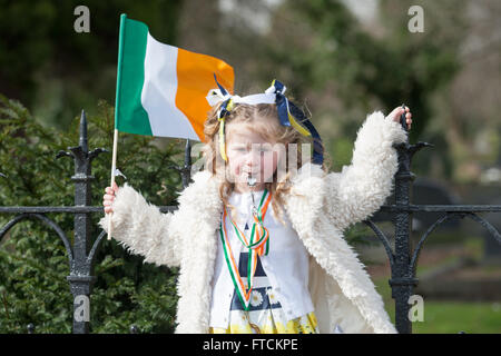 Falls Road, Belfast,UK 27th March 2016 A young girl waving a irish flag and blowing a whistle during the Easter - Stock Photo