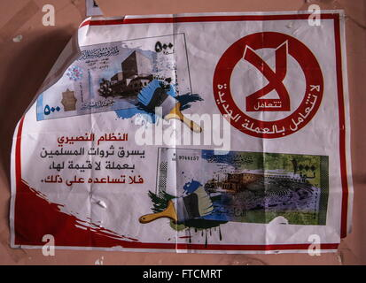 Palmyria, Syria. 26th Mar, 2016. A leaflet calling on not to use new Syrian banknotes, in an abandoned ISIS headquarters - Stock Photo
