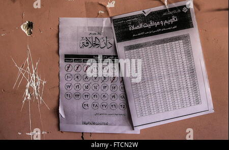 Palmyria, Syria. 26th Mar, 2016. A timetable showing prayer times in an abandoned ISIS headquarters in Palmyra. - Stock Photo