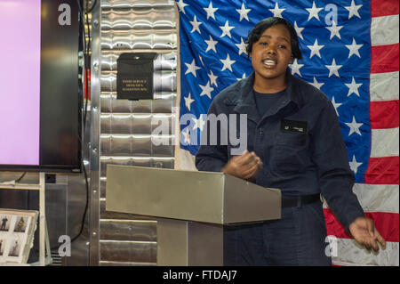 150325-N-XB010-023 MEDITERRANEAN SEA (March 25, 2015) Seaman Najae Phillips from Brooklyn, New York, sings at the - Stock Photo