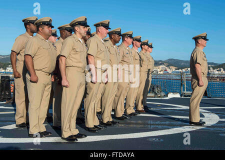 150401-N-VC236-009 PALMA DE MALLORCA, Spain (April 1, 2015) - Chief petty officers assigned to the Arleigh Burke-class guided-missile destroyer USS Farragut (DDG 99) observe morning colors to commemorate the 122nd CPO birthday April 1, 2015. Farragut, homeported in Mayport, Florida, is conducting naval operations in the U.S. 6th Fleet area of operations in support of U.S. national security interests in Europe. (U.S. Navy photo by Mass Communication Specialist 3rd Class Jackie Hart/Released)