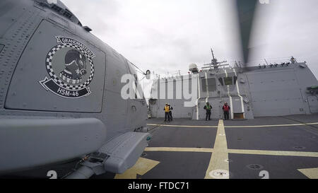"""150501-N-ZE250-002 ATLANTIC OCEAN (May 1, 2015) An MH-60R Seahawk helicopter, assigned to """"Grandmasters"""" of  Helicopter - Stock Photo"""