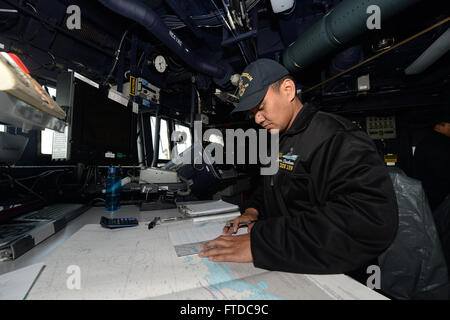 150505-N-ZE250-004 BALTIC SEA (May 5, 2015) Quartermaster 2nd Class Francis Mengote, from San Diego, plots points - Stock Photo