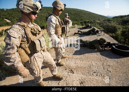 150625-M-YH418-009: VOLOS, Greece (June 25, 2015) - Corporals Dustin Cooper, left, and Moses Monreal, both riflemen with the 24th Marine Expeditionary Unit (MEU), observe Greek Marines with the 521st Marine Battalion fire their weapons during a marksmanship competition at a training site near Volos, Greece, June 25, 2015,  as part of a bilateral training exercise.  The 24th MEU is embarked on the ships of the Iwo Jima Amphibious Ready Group and is conducting naval operations in the U.S. 6th Fleet area of operations in support of U.S. national security interests in Europe. (U.S. Marine Corps ph Stock Photo