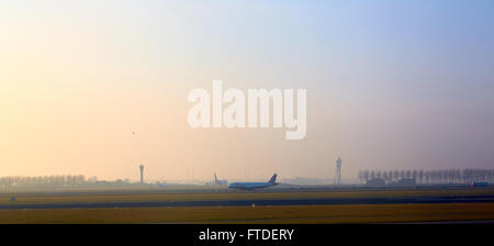 Airplane departing from Airport Schiphol. - Stock Photo