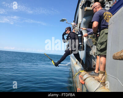 150827-ZZ999-N-3807 ADRIATIC SEA (Aug. 27, 2015) Navy Diver 2nd Class David Savell enters the water from USNS Grasp - Stock Photo